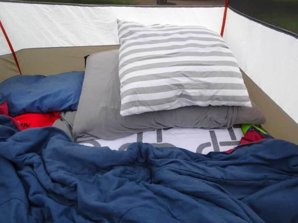 striped small pillow in a tent