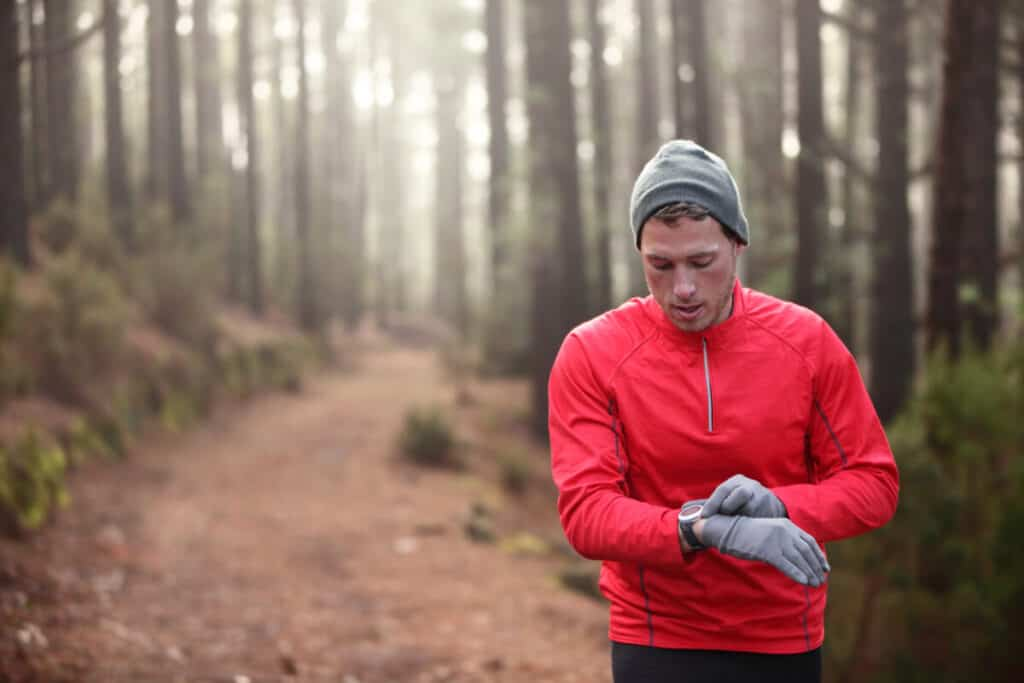 guy-wearing-red-while-hiking-or-running-in-forest