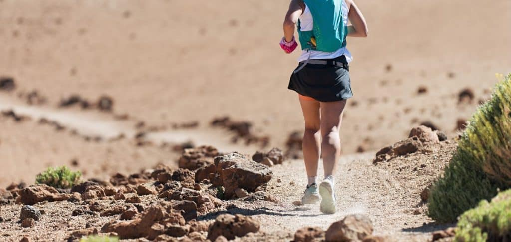 woman-running-with-hydration-pack