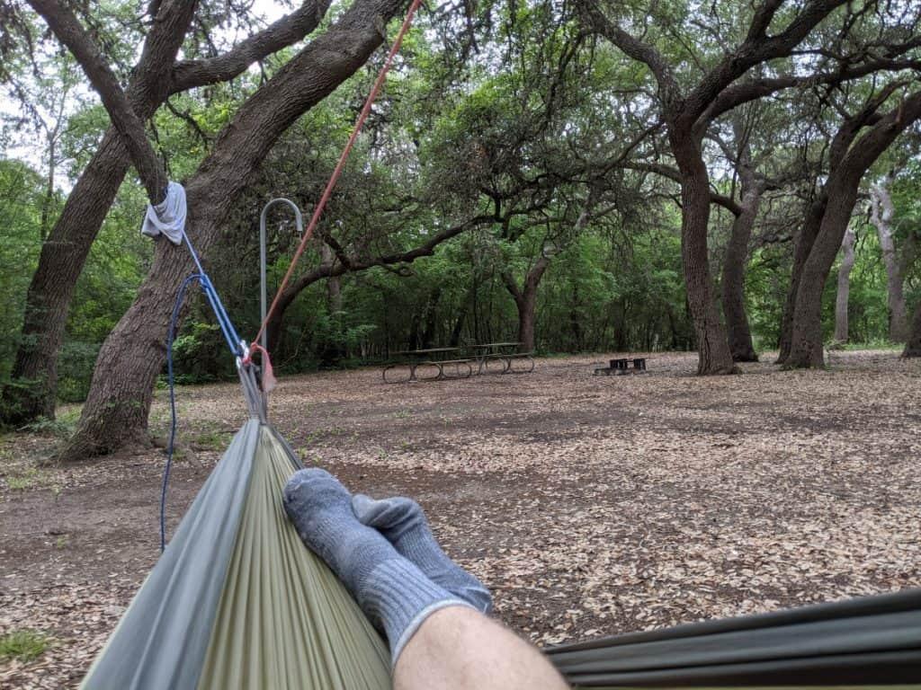 feet-hanging-off-one-side-of-hammock