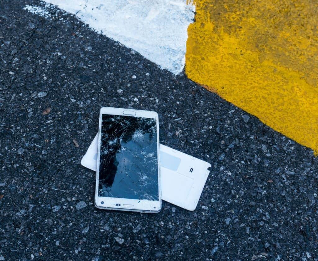 broken-phone-on-asphalt